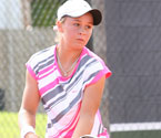 Ashleigh Barty playing in the girls singles final