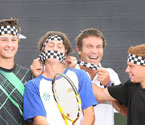SERVING IT UP: Pat Cash gives AIS Academy tennis player Andrew Whittington a mouthful of his famous chquered headband while Joey Swaysland (left) and Sean Berman look on