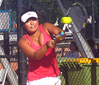 Stephanie Yamada playing a backhand shot during the doubles final