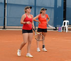 Anja Dokic and Zoe Hives waiting for the outcome of a line call during the girls doubles final