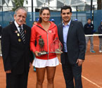 Gallipoli Youth Cup girls' champion Ipek Soylu receives Sands of Gallipoli figurine and Crystal Trophy from Turgut Kacmaz (the son of the last Turkish veteran of Gallipoli) and Umit Oraloglu (Founder of the Gallipoli Youth Cup)