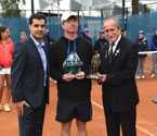Gallipoli Youth Cup boys' champion Mitchell Pritchard receives Sands of Gallipoli figurine and Crystal Trophy from Turgut Kacmaz (the son of the last Turkish veteran of Gallipoli) and Umit Oraloglu (Founder of the Gallipoli Youth Cup)