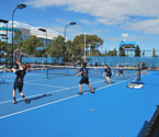 Students participating in a range of tennis activities